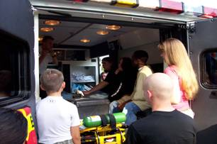 Teenagers inspecting an EMS truck